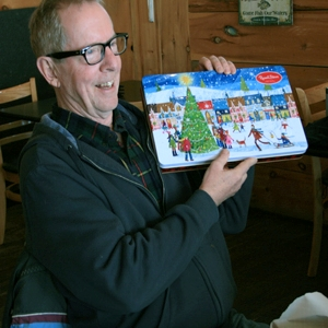 Dave Allen gets the Christmas prize of Janice Andrews' cookies at the Canoe FM Board of Directors meeting but he did not have it long