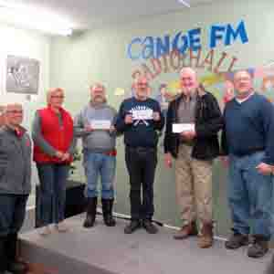 Canoe FM's Bob Stiles, Roxanne Casey and Ron Evans received their portion of the profit ($4,533.69) from the Haliburton Highlands Outdoors Association's Catch the Ace Draw from Dennis Casey, Larry Hewitt and Rusty Rustenburg.