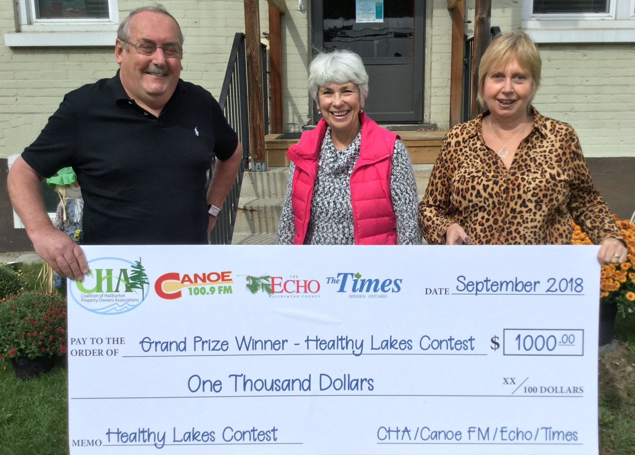 The $1,000 winner from the CHA contest was Nita and Gary Acker of Dorset – Nita is pictured with Paul MacInnes of the Coalition of Haliburton Property Owners' Associations and Roxanne Casey Manager of 100.9 Canoe FM