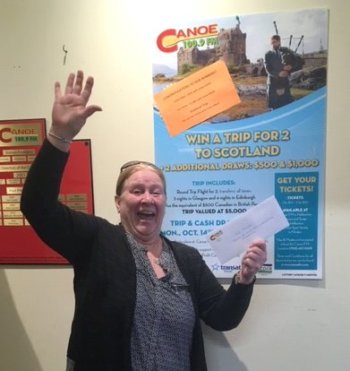 Canoe FM listener, Sue Payne picking up her $1000.00, one of the prizes from the Trip to Scotland Draw done on October 16, 2019