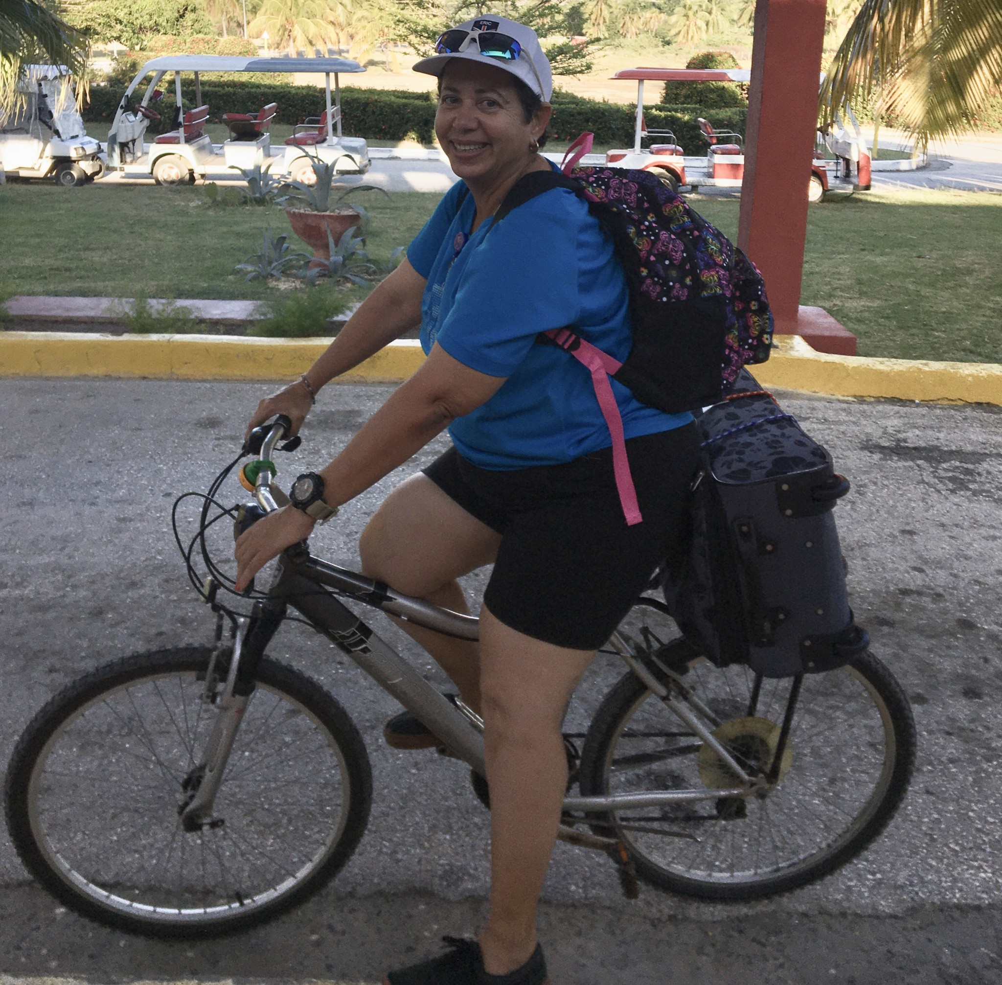 """Listeners, Lynn & Doug Deringer sent this to Canoe FM """"Here is Elena from Marea del Portillo, Cuba delivering our gifts from Haliburton/Minden to families in need in a neighboring area.  Most of the Canoe FM pens went with her and we also distributed some around the resort to the front desk and staff.  Elena works 6 days a week at the resort and delivers gifts on Sunday."""""""